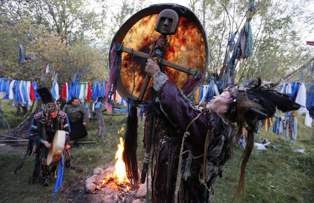 """Tuvan shamans participate in a ritual called """"Kamlanie"""" outside the Kyzyl town, the administrative centre of Russia's Tuva region, some 800 km (497 miles) south of Siberian city of Krasnoyarsk, September 13, 2011. Eight shamans, members of """"The Spirit of Bear"""" society took part in the traditional ritual. Tuvans, one of Asian nomadic peoples, practise two main religions - Buddhism and Shamanism.  REUTERS/Ilya Naymushin  (RUSSIA - Tags: SOCIETY RELIGION)"""
